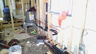 plumbing installation inside of shipping container