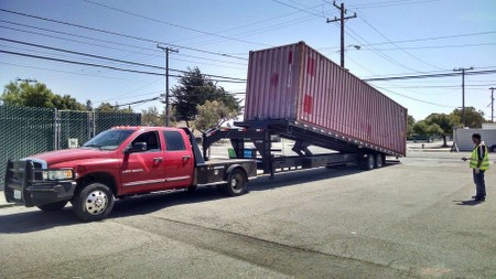 all bay trucking tilt bed container delivery
