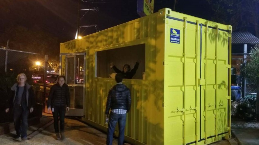 yellow shipping container with cargo doors conexwest sign modified pop up shop shipping container storage containers