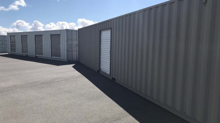 storage container with roll up door grey color blue sky cloud shipping containers with roll up doors man doors modified container