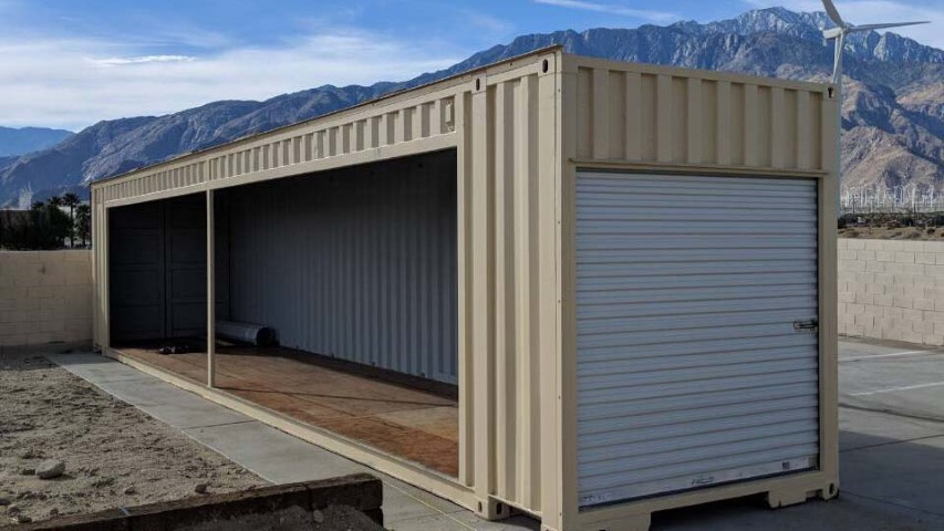 cream color modified container shipping container storage container roll up door opened metal container