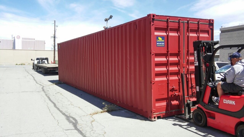 red color shipping container red storage container blue sky cloudy forklift red color forklift