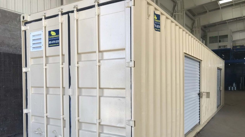 modified container cream color cargo doors with roll up door conexwest sign