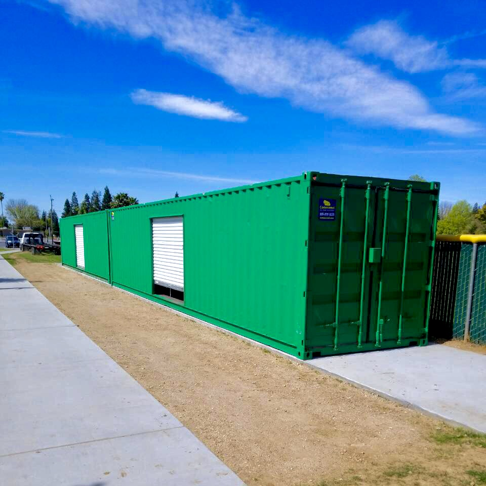 Shipping container with a roll up door