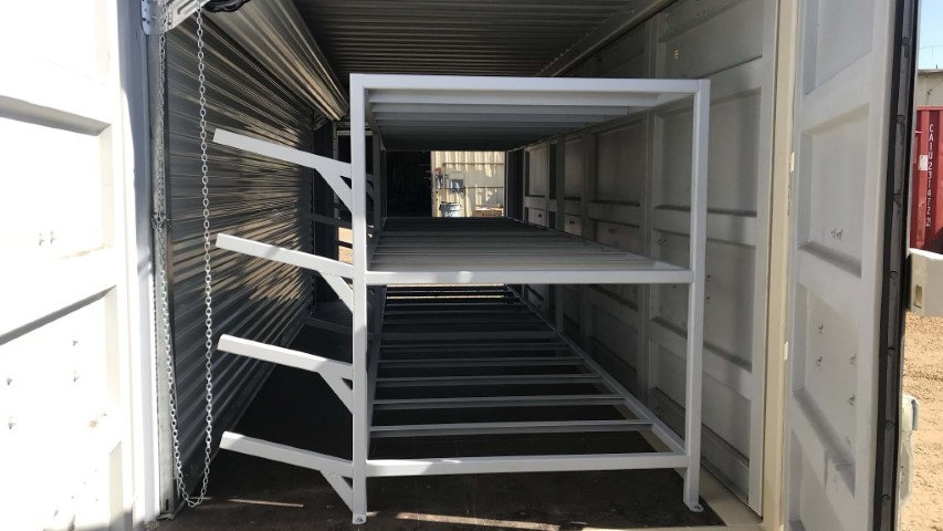 shelving unit inside shipping container and storage container cargo doors opened