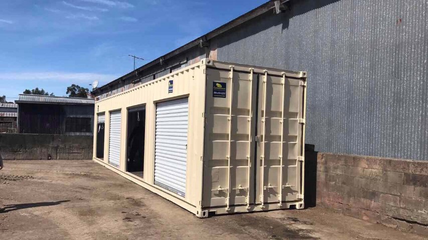 shipping container roll up door storage container roll up door blue skies factory facility cream color storage container