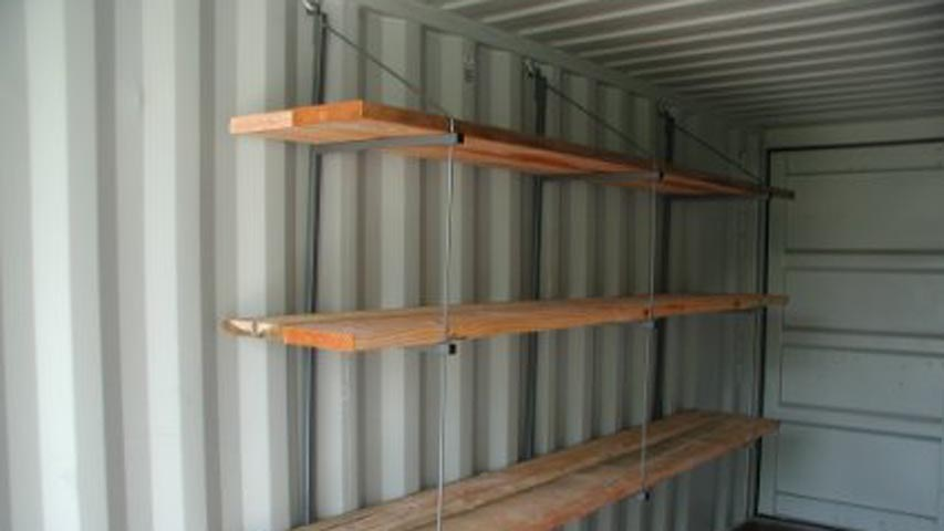 Removable shelving system for shipping containers for rent