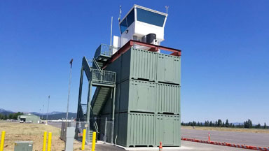 Truckee container tower airport blue sky conexwest green storage container