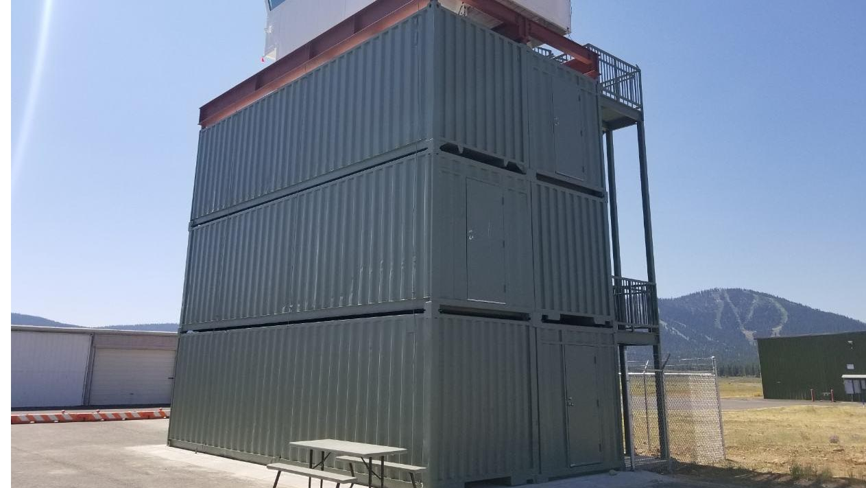airport tower Truckee  California shipping containers stacked on top of each other blue Sky