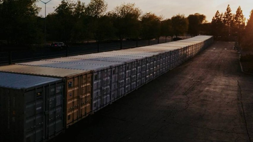 sunset trees orange shipping container storage container line up conexwest containers