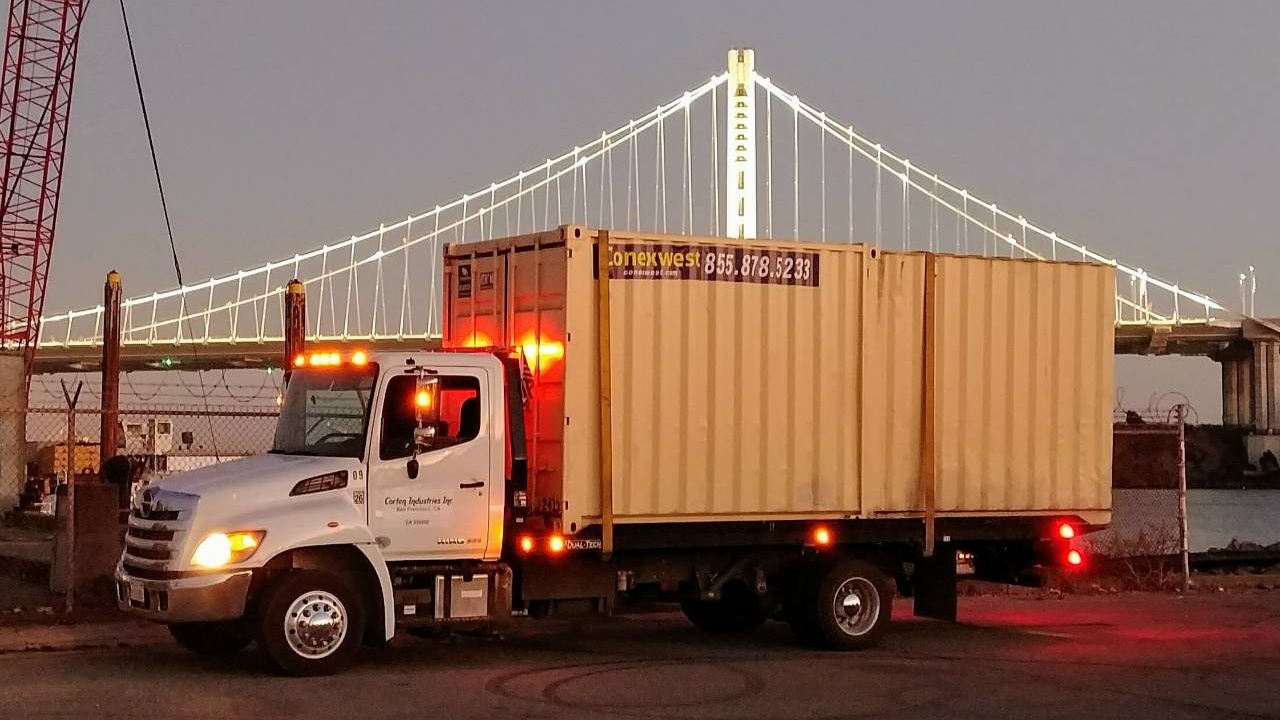 20ft shipping container on a flatbed truck