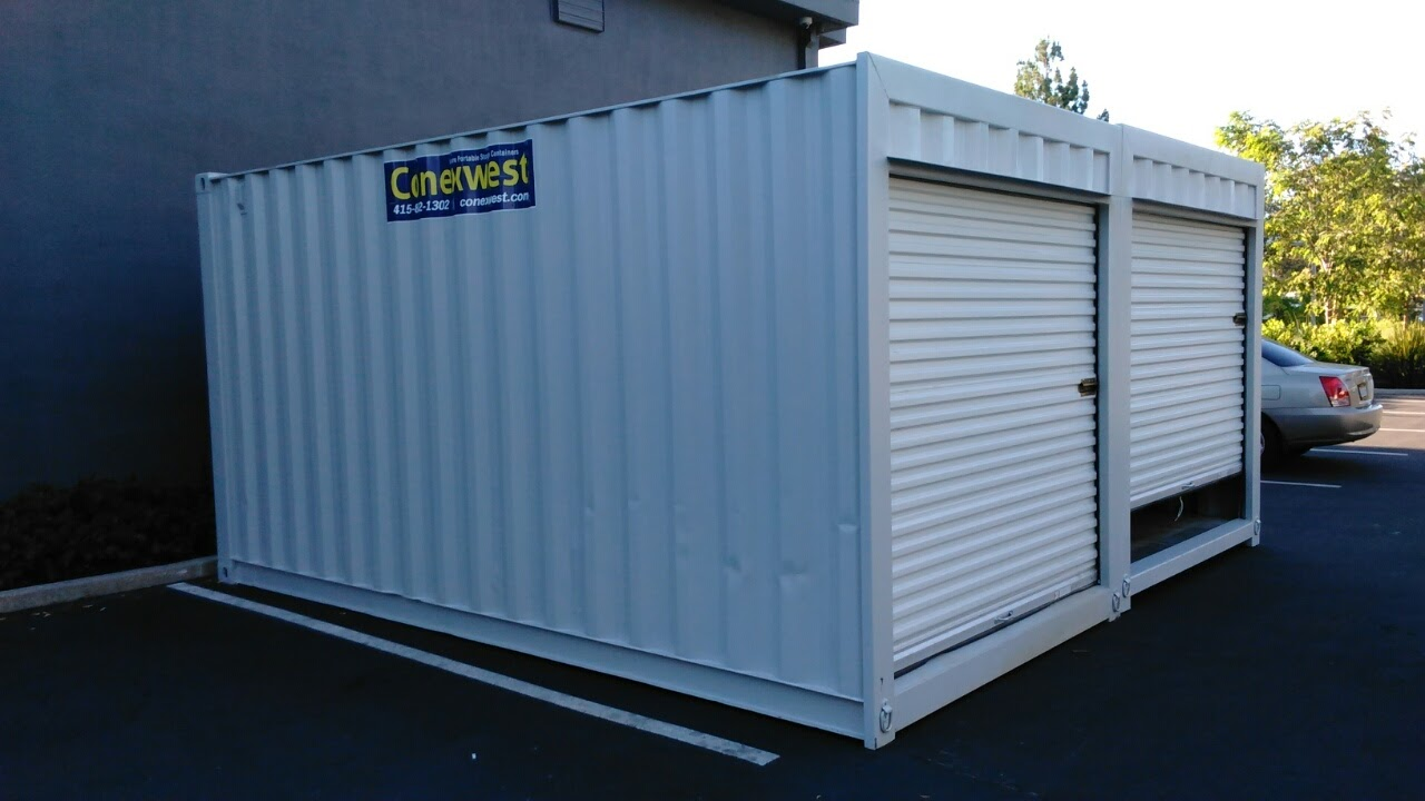 Two 16' storage containers with roll up door for sale