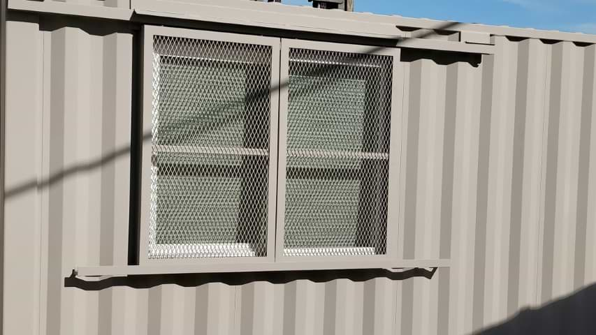 Barn door window security for storage container for sale