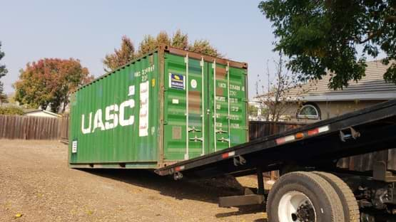 Slide off shipping container delivery