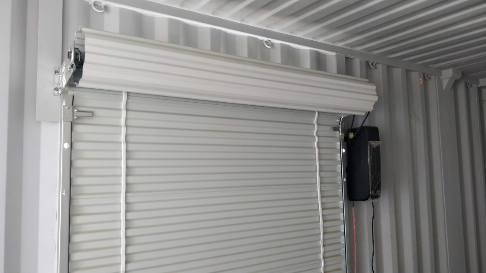 Powered roll up door add on