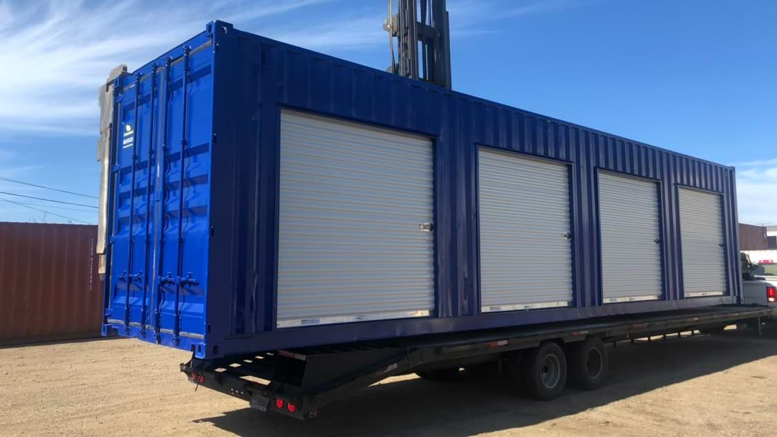 Blue storage container with roll up doors