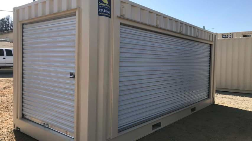 roll up door garage door shipping container storage container cream color conexwest sticker blue sky dirt road container