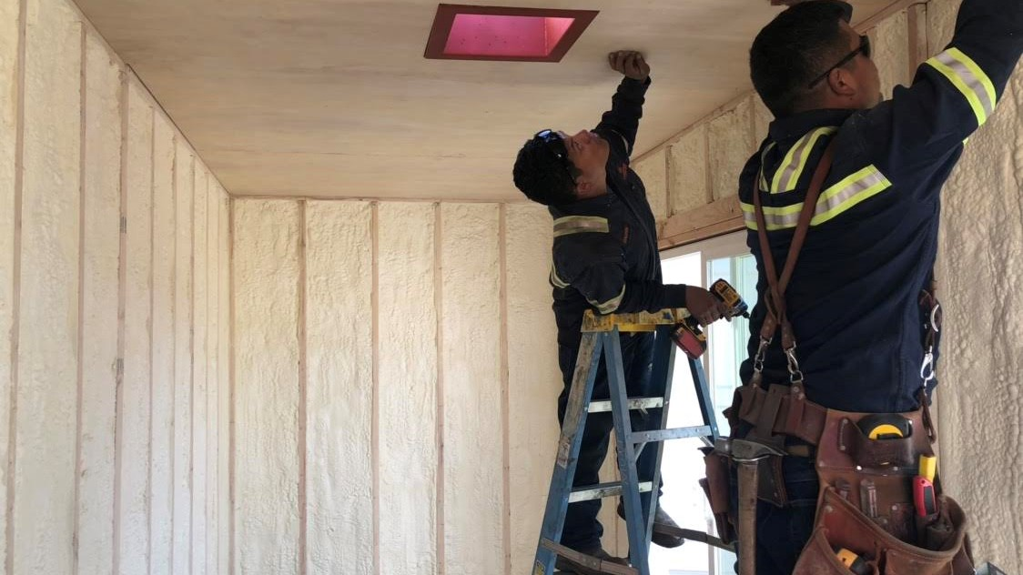closed cell foam spray inside of shipping container home