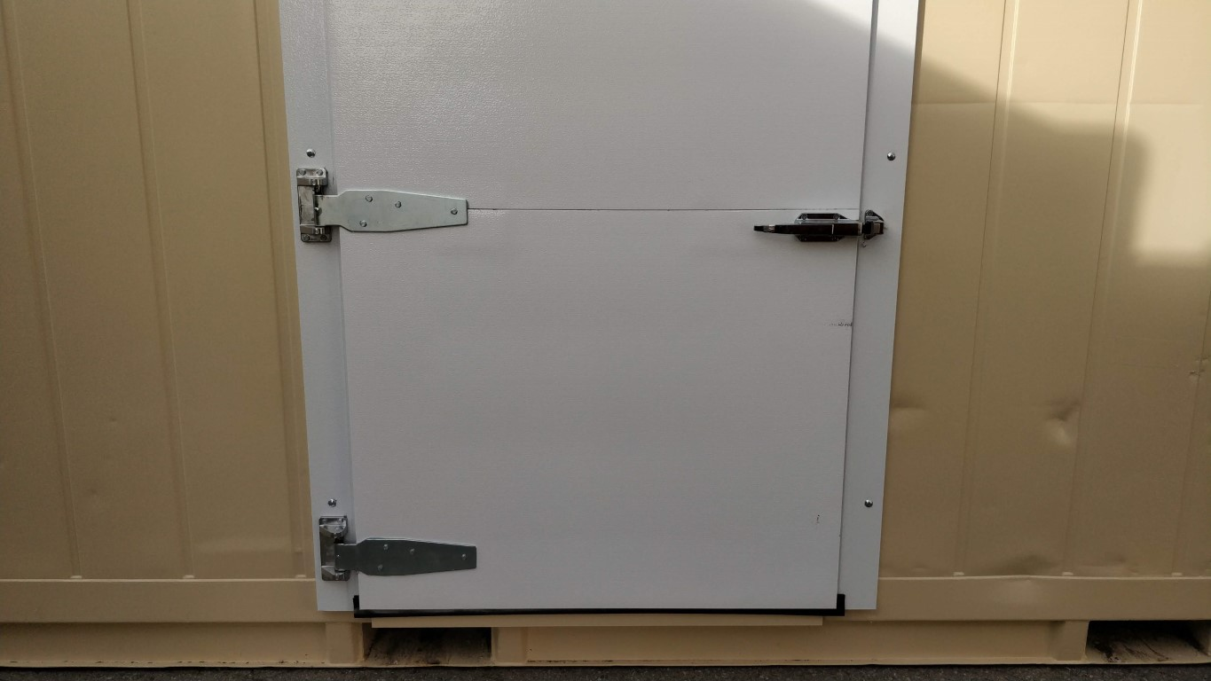 Butcher door for refrigerated sold storage containers