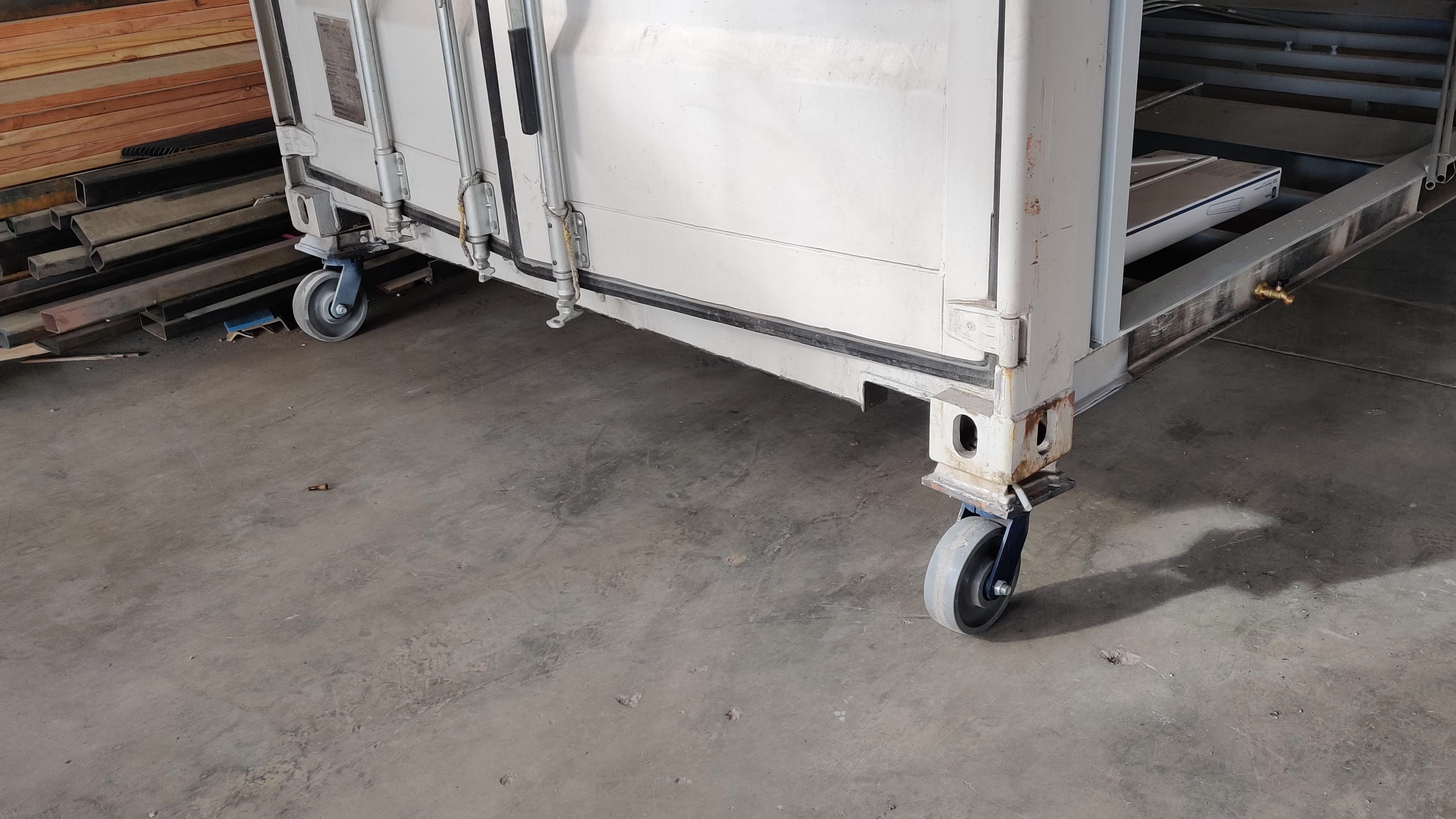 Shipping container caster wheels