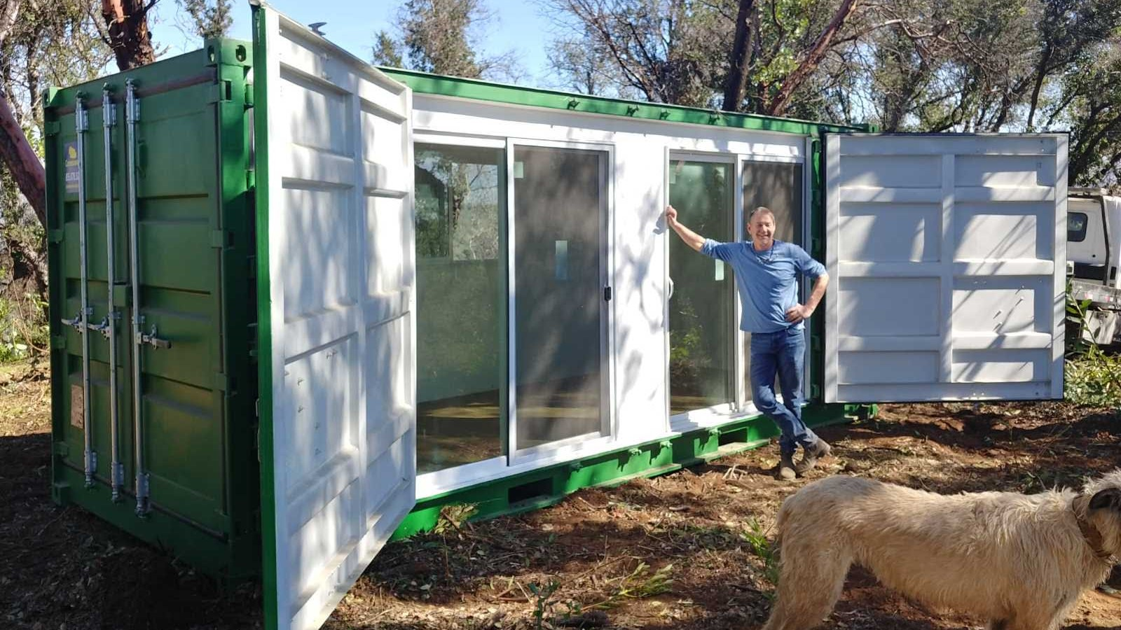 Modified shipping container home green color