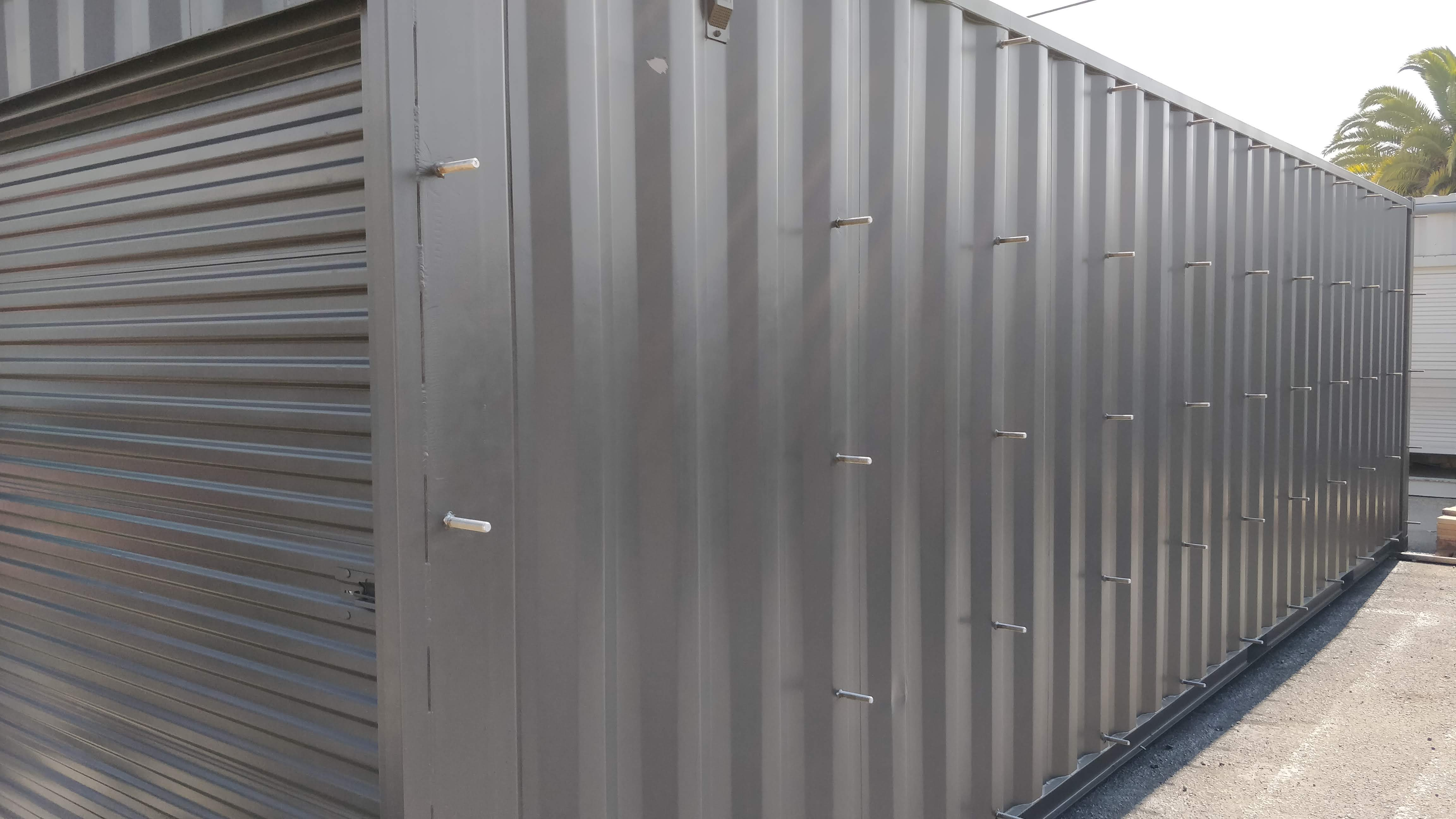 Custom rail attachments on gray shipping container