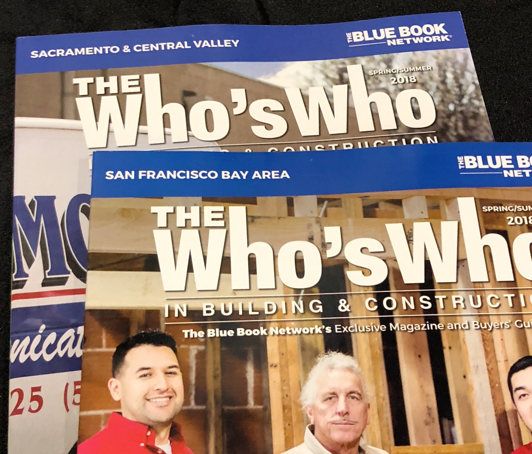magazines provided by the blue book network at the who's who showcase for the networking event