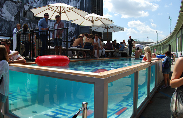 Shipping container swimming pools events with conexwest blue water red bull