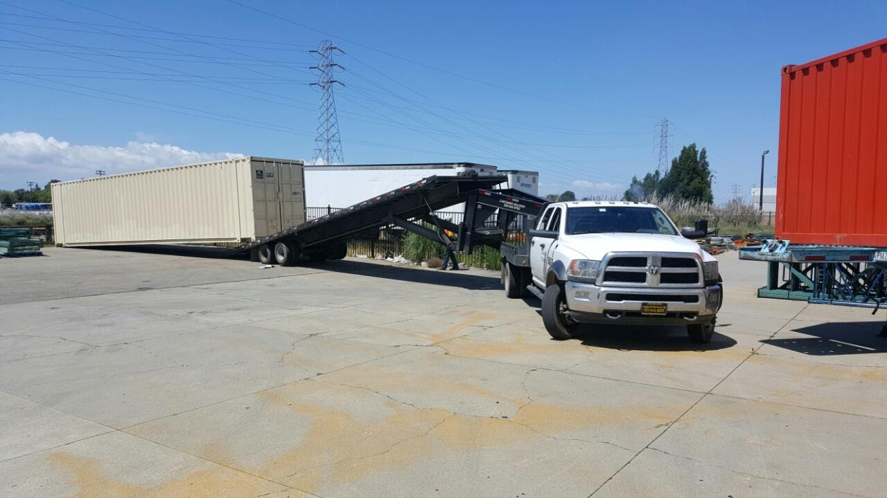 Placing shipping and storage container  on the ground by Conexwest